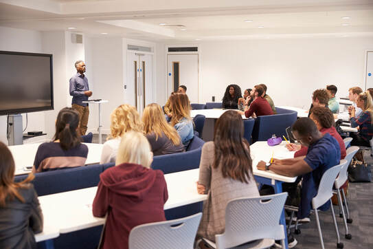 students study in a classroom with male lecturer